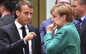 ilrative french president emmanuel macron left speaking with german chancellor angela merkel during