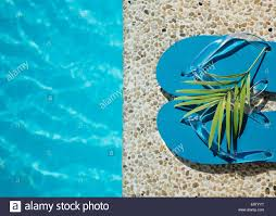 pool water background. Flip Flop On Wood Floor Pool Edge With Surface Of Water Background