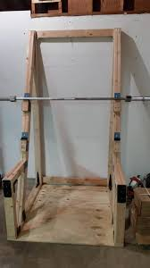 squat rack simple and minimalistic with some planks of strong wood a metal bar and some s and voila you have a basic simple yet really sy