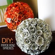 via kraftykristin diy paper rose spheres via decorative paper rose spheres diy saved by love creations find this pin and more on book pages repurposed
