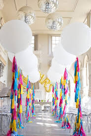bright and white wedding with oversized balloons tassels and glamour love