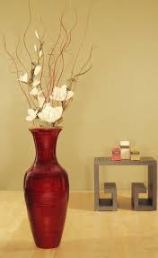 <br> <li>Accent your home decor with this bamboo floor vase and