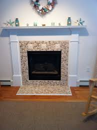 tan and white pebble tile fireplace surround and hearth