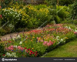 english country cottage garden flowers stately home stock photo