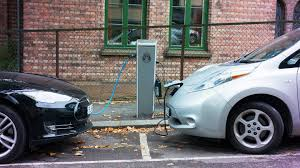 electric cars charging. charging · electric car evs tech. getty images / peter ptschelinzew cars g