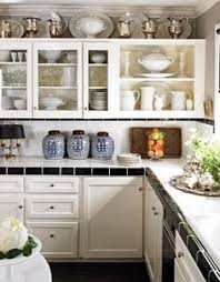 decor above kitchen cabinets. The Tricks You Need To Know For Decorating Above Cabinets Laurel Home  Conventional Kitchen Cabinet Decor Realistic 1 - Outstanding Interior Inspiring Ideas. Decor Above Kitchen Cabinets I