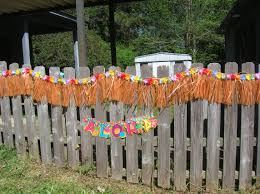 Decorating With Raffia Fascinating Orange Fringed From Raffia Material On Nice Fence