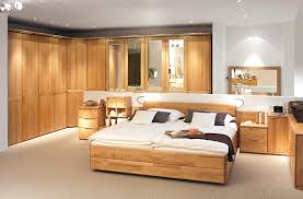 orange bedroom furniture. Large Bedroom Design Collection From Hulsta : Master With Wooden Wardobe And Bedside Table Orange Furniture