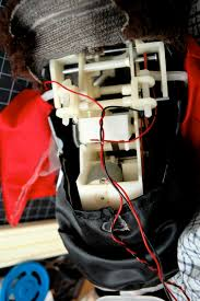lab dc motor control using an h bridge itp physical computing photo of a toy monkey the back has been removed to reveal the inner gear
