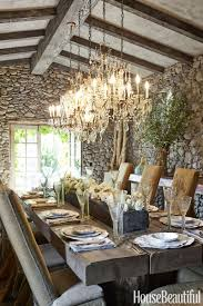 designer wendy owen made the dining table on her sonoma property from antique salvaged beams she slipcovered the ron mann design chairs in vine burlap