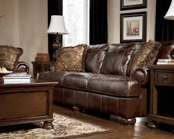 leather sofa design with cushions and wooden coffee table under the white shade desk lamp