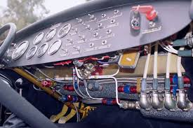 steve sanett s 1962 daimler sp250 aluminum chevy 427 v8 stewart warner mechanical gauges jones motrola mechanical tachometer teflon insulated silver wire and aluminum mil std connectors