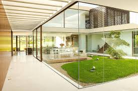 more than opening the interior of the home and merging it with the outside world frameless glass doors greatly improve ventilation and increase natural
