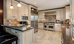 white cabinets dark countertop. upscale kitchen in luxury home with breakfast bar white cabinets dark countertop e