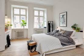 cozy blue black bedroom. Aquamarine Tufted Bedcover Artistic Glass Chandelier Plain Bright Wall Paint Black Wooden Bedside Drawer Navy Blue Cozy Bedroom I