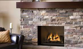 modern stack stone square frame fireplace with dark brown wood mantel to place ornaments and some interiors dark brown leather sofa with pastel gold square
