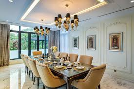 a number of discrete details have been incorporated into this dining space in order to bring the classic style to modern times reflective trim around the
