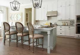 restoration hardware vintage french round cane back fabric stools sit at a gray beadboard kitchen island ed with gray turned legs and a gray quartzite
