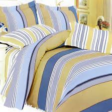 pale yellow painted simple bedroom with multi colors plaid coverlet and blue and yellow bedding set