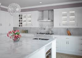 modern kitchen with large clean island and white kitchen cabinets