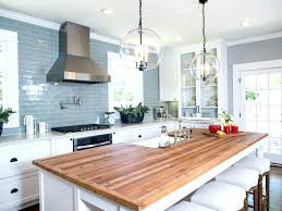 image of white cabinets with butcher block countertops walnut