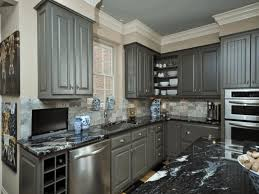 black granite countertop cream wall painting white frame window dark grey kitchen cabinet