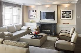 modern apartment living room design. Eye Catching Fireplace TV Feat Calm Fabric Living Sofas And Square Upholstery Ottoman Coffee Table In Relaxing Small Room Modern Apartment Design