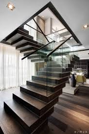 Modern glass and wood staircase featured at One&Only Hotel, Penthouse  Apartment One designed by: Keith Interior Style + Architecture