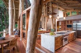 4 tags Tropical Kitchen with Cathedral ceiling, Bellmont Cabinets- Kahana,  One-wall, Flush