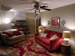 charming red sofa in living room neutral wall colors patterned area rug white ceiling mounted open shelves rugs furniture accessories various design of home