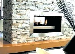 studio 2 duplex gas fire with black lining shown as an edge installation double sided fireplace