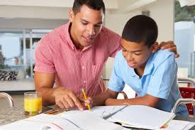 Mother Helping Children Do Their Homework Stock Photo Image Parents helping  their children with homework Stock