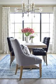 dumont dining table black tufted dining chairs vintage inspired blue rug transitonal modern dining room