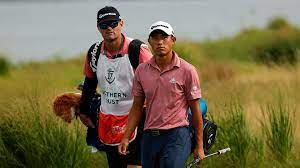 Battling back injury, Collin Morikawa ...