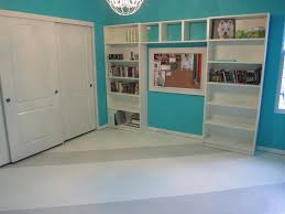 painting concrete floor with white and gray color in home library combined with brown wall interior color and wall built in bookshelf ideas