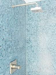 penny round tile the sharp angles of the shower head and water valve offers a sleek penny round