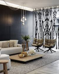 sitting room lighting. black macrame space divider creates an eye catching accent for this living sitting room lighting