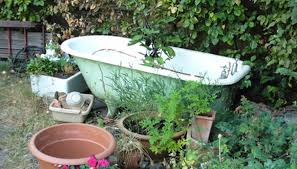 antique claw foot tubs with substantial s are best suited as garden accessories