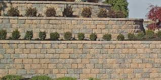 concrete block is very durable and designed specifically for retaining walls
