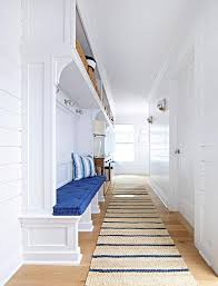 long beach bungalow mudroom with blue striped jute rugs