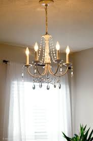here is another fantastic chandelier makeover that you will just love to copy here an old light chandelier has been refurbished and then added with crystal