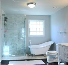 clawfoot tub glass shower enclosure decorating bathroom with tub and dark flooring using white toilet seat