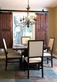 marvelous barn door window treatments o4307779 barn door window view of indoor shutter barn door window