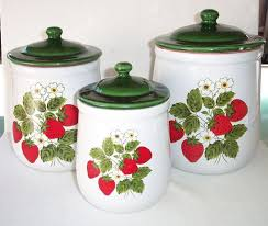 green lids strawberry ceramic decorative kitchen canisters sets on white countertop kitchen island in front