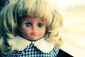 a modern doll looks out with unnaturally piercing blue eyes mariadubova istock photo
