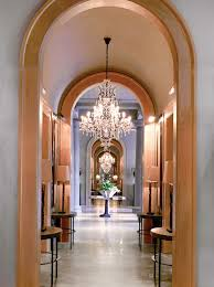 a 19th century rococo chandelier lights a passageway