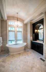 classic bathroom lighting. beautiful bathroom love the black vanity with gray marble light fixture over classic lighting