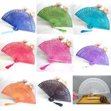 chinese style wedding favors gift fans candy color hollow out sandalwood folding cutout wood hand craft fan with tel dhl unusual wedding favors wedding