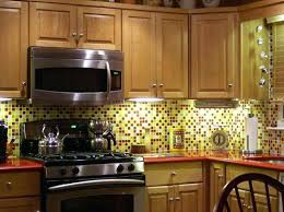 yellow kitchen backsplash the advantages of glass tiles for