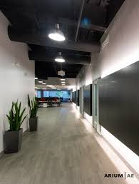 Black Ceilings corridor in an office space with black laminate accent wall with 7798 by uwakikaiketsu.us